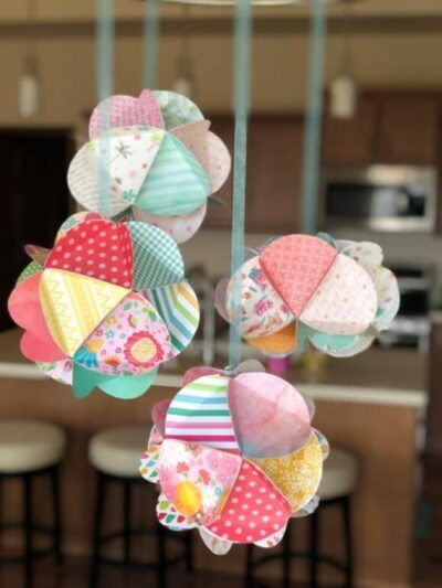 Colorful Paper Globes Hanging by Ribbon