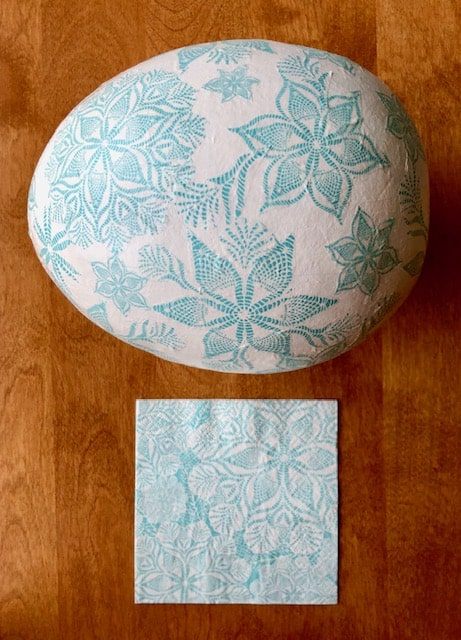 Blue and white print napkin with finished egg