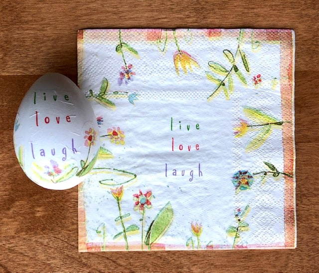Live, love, laugh print napkin with finished egg