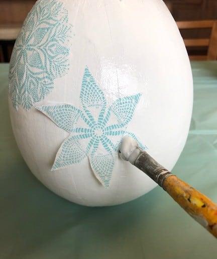 2nd blue and white shape glued onto the egg