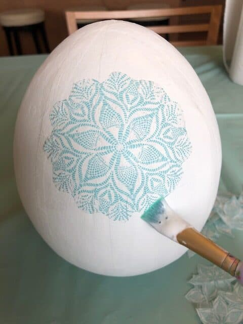 Adding blue and white shape to the egg