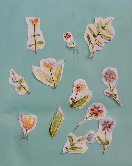 Small flowers cut from a napkin