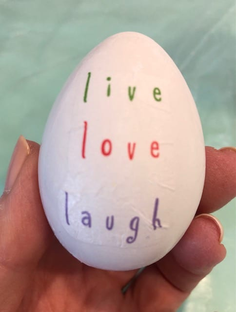 live, love, laugh on front of egg