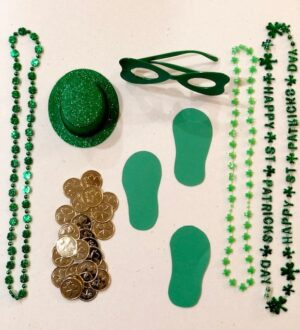 St. Patrick's Day party favors with necklaces, hats, glasses, gold coins, and green footprints