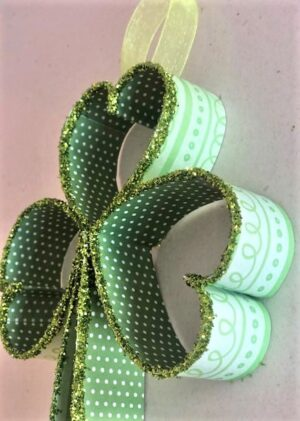 Side view of shamrock with polka dot and print green paper