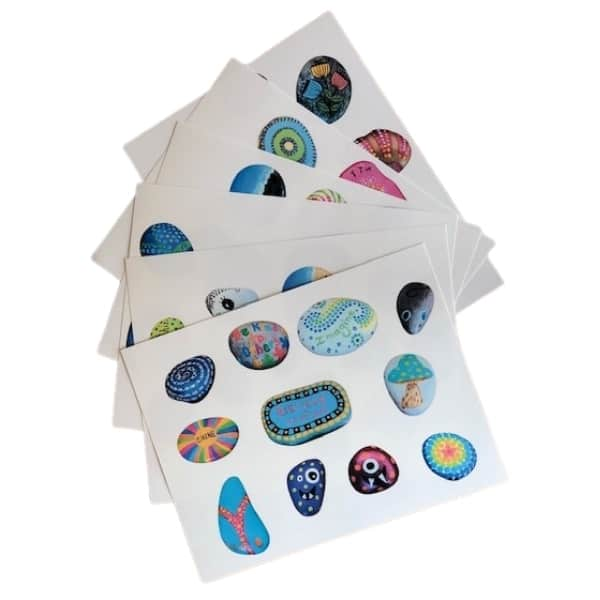 Samples of painted rocks printed on card stock