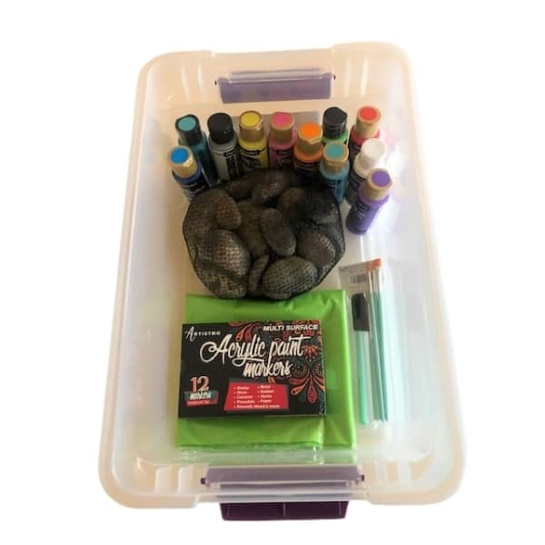 Box with paints, stones, brushes, markers, & tablecloth